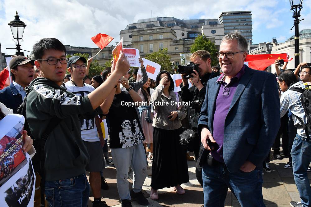 Here are two western popaganda journalist intimidating Pro-China for their evil demonic tongue. The fact, demonic tongue exccuse other in fact saying about themselves evildoer and we don't need a human translator in Trafalgar square on 17 August 2019, London, UK.