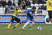 Hartlepool United striker Jake Gray and Ashley Hemmings (Midfielder) Dagenham & Redbridge compete for the ball during the Sky Bet League 2 match between Hartlepool United and Dagenham and Redbridge at Victoria Park, Hartlepool, England on 12 March 2016. Photo by George Ledger.