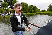 Joe Caulfield pulls a float across the water during a treasure hunt at the Caulfield/Mulryan family reunion at Ardenode Stud, County Kildare, Ireland on Sunday, June 23rd 2013. (Photo by Brian Garfinkel)