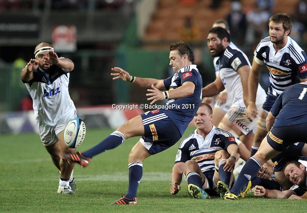 Dewaldt Duvenage of the Stormers clears under pressure against the Blues<br /> <br /> &copy;Ryan Wilkisky/BackpagePix