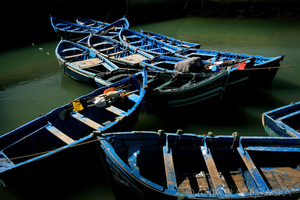 Morocco, Essaouira. Blue boats on the water.