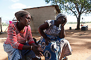 Mother &amp; Daughter Francina and Selina Netshakhuma have lived and worked on a farm near Musina for several years. When the farm was sold the new owner no longer required their services and threatened them with eviction without giving them an alternative place to go. The Legal Resources Centre has assisted them with legal advice and prevented them from becoming homeless. This case illustrates the vulnerability of rural farm workers who have no security of tenure. Near Musina, Limpopo, South Africa.<br /> <br /> <br /> Photograph by Zute Lightfoot