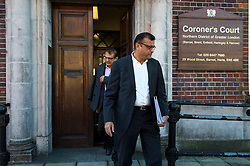 © Licensed to London News Pictures. 09/10/2015. London, UK. Anni Dewani's father Vinod Hindocha (back) and uncle Ashock Hindocha (front) leaving North London Coroner's Court in Barnet, north London where a Coroner ruled there will be no inquest into murdered honeymoon bride Anni Dewani. Photo credit: Ben Cawthra/LNP