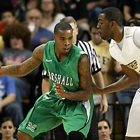 Marshall forward Tirrell Baines (30) drives the ball against Central Florida forward Keith Clanton (33) during a Conference USA NCAA basketball game between the Marshall Thundering Herd and the Central Florida Knights at the UCF Arena on January 5, 2011 in Orlando, Florida. Central Florida won the game 65-58 and extended their record to 14-0.  (AP Photo/Alex Menendez)