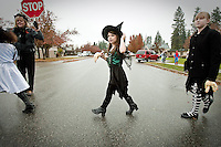 JEROME A. POLLOS/Press..Rheana was very excited to find her other boot to complete her witch outfit for the Borah Elementary Halloween Parade held Friday, Oct. 30, 2009. She was very cute and happy to receive a glove full of popcorn with candy corn fingernails.
