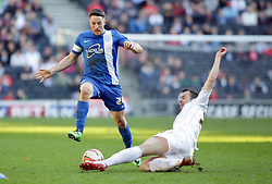 Peterborough United's Conor Washington is tackled by Milton Keynes Dons' Antony Kay - Photo mandatory by-line: Joe Dent/JMP - Mobile: 07966 386802 15/03/2014 - SPORT - FOOTBALL - Milton Keynes - Stadium MK - MK Dons v Peterborough United - Sky Bet League One