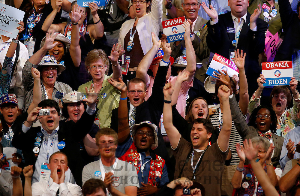 Delegates cheer during the second session of the Democratic National Convention in Charlotte, North Carolina, September 5, 2012. REUTERS/Chris Keane (UNITED STATES - Tags: POLITICS ELECTIONS)