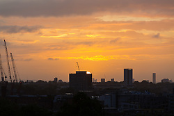 London, September 11 2017. The sun emerges from below the horizon making a silhouette of the London skyline as a new day breaks over the city. © Paul Davey