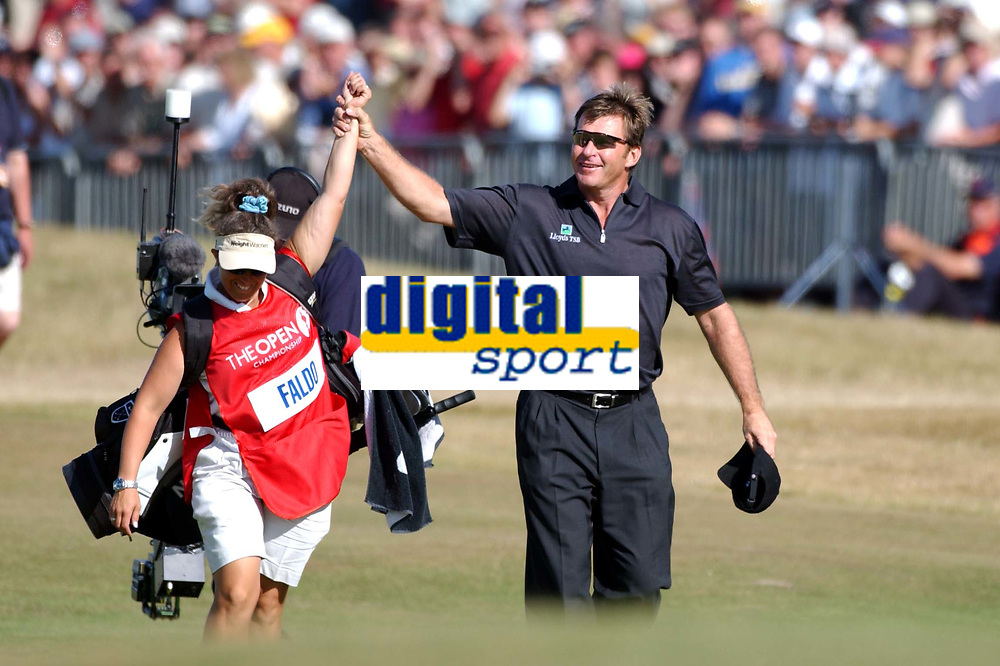 Nick Faldo (England) lifts up the arm of caddie Fanny Sunnesson as he milks the applause of the galleries on the 18th green as he completes his round of 70. The Open Golf Championship, Royal St.Georges, Sandwich, Day 4, 20/07/2003. Credit: Colorsport / Matthew Impey DIGITAL FILE ONLY