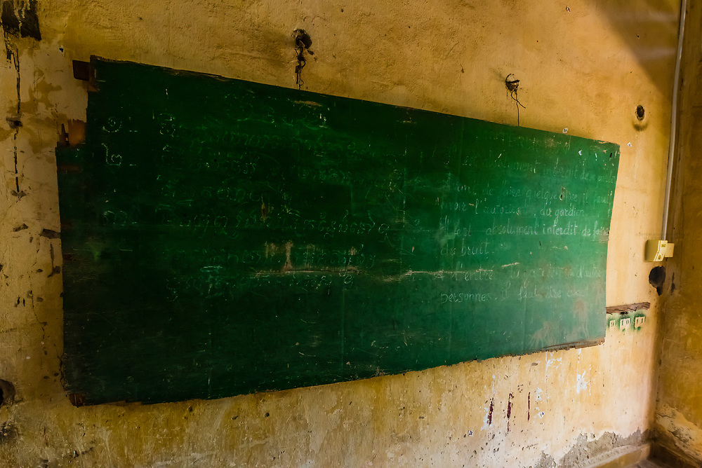 "On the right side of this chalkboard it is written in French ""it is absolutely forbidden to make noise"" during torture;Tuol Seng Genocide Museum; originally a school, it was turned into the Khmer Rouge Torture headquarters. Men, women and children were tortured and killed before being moved under darkness to be buried in mass graves at the Killing Fileds of Choeung Ek (outside the city); Phnom Penh, Cambodia."