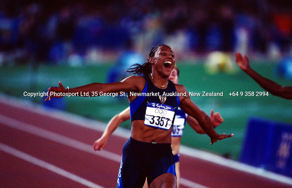 Marion Jones of the United States celebrates winning gold in the womens 100m final at the Olympics, Sydney, Australia, 23 September 2000.  PHOTO: PHOTOSPORT