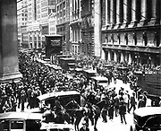 Crowds gather outside the New York Stock Exchange dring the Wall Street Crash in 1929