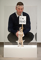 © London News PIctures. 31/01/2012. Artist  David Shrigley poses next to artwork of a taxidermied Jack Russell titled 'I'm Dead (2010)' at a press viewing of exhibition 'Brain Activity, by British artist David Shrigley at the Hayward Gallery, London on January 31st, 2012. Photo credit: Ben Cawthra/LNP