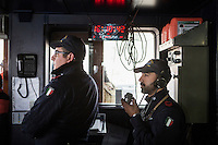"VALLETTA, MALTA - 8 FEBRUARY 2017: Italian Navy staff is seen here at work during a maneuver in the pilot house of the San Giorgio, an amphibious transport dock of the Italian Navy, as it sets out of the harbor of Valetta, Malta, on Febuary 8th 2017.<br /> <br /> As a consequence of the April 2015 Libya migrant shipwrecks, the EU launched a military operation known as European Union Naval Force Mediterranean (EUNAVFOR Med), also known as Operation Sophia, with the aim of neutralising established refugee smuggling routes in the Mediterranean. The aim of this new operation launched by Europe is to undertake systematic efforts to identify, capture and dispose of vessels as well as enabling assets used or suspected of being used by migrant smugglers or traffickers. On 20 June 2016, the Council of the European Union extended Operation Sophia's mandate reinforcing it by supporting the training of the Libyan coastguard.<br /> Thus far, following EUNAVFOR MED operation Sophia's activities, 101 suspected smugglers and traffickers have been apprehended and transferred to the Italian<br /> authorities and 380 boats were removed from the criminal organizations' availability. The Operation has saved 32.081 migrants, among whom 1888 children.<br /> <br /> On February 2nd 2017 Italian Premier Paolo Gentiloni and Prime Minister of the U.N. backed Libyan government Fayez al-Serraj signed a memorandum of understanding on cooperation to combat illegal migration, human trafficking and contraband and on reinforcing the border between Libya and Italy. The following day, as EU leaders meet in Malta for a summit, European Council President Donald Tusk said after talks with Serraj, that ""it is time to close the (migrant) route from Libya to Italy"" and that ""the EU has shown it is able to close the routes of irregular migration, as it has done in the eastern Mediterranean.""  Tusk said the Central Mediterranean route was ""not sustainable either for the EU or for Libya"", where he said traffickers were undermining"