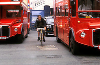 Cyclist without helmet through traffic London