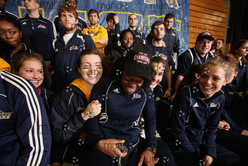 (Windsor, Ontario---13 March 2010) \ The University of Windsor Lancers celebrate their victory in the women's team competition at the 2010 Canadian Interuniversity Sport Track and Field Championships at the St. Denis Center. Photograph copyright GEOFF ROBINS/Mundo Sport Images. www.mundosportimages.com