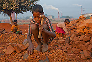 A 10-year old brick maker working outside of Dhaka in Bangladesh.  He and others like him make about $1.40 each day.
