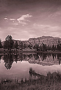 Dramatic Sunset on Hayden Peak Reflected In a Pond in the Uinta Mountains of Utah.Black & White.
