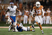 AUSTIN, TX - NOVEMBER 7:  Jerrod Heard #13 of the Texas Longhorns scrambles against the Kansas Jayhawks  on November 7, 2015 at Darrell K Royal-Texas Memorial Stadium in Austin, Texas.  (Photo by Cooper Neill/Getty Images) *** Local Caption *** Jerrod Heard