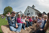 The Cornelissen Family from Meredith and the Kliche family from Alton Bay are among the visitors enjoying a hayride Saturday afternoon during the 2nd annual Harvest Festival at Prescott Farm Environmental Education Center.  (Karen Bobotas/for the Laconia Daily Sun)