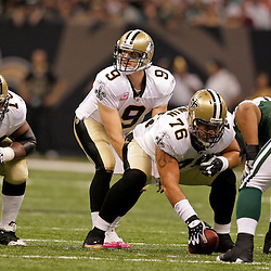 2009 October 04: New Orleans Saints quarterback Drew Brees (9) under center during a 24-10 win by the New Orleans Saints over the New York Jets at the Louisiana Superdome in New Orleans, Louisiana.