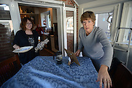 Denise Held (left) and Jean Rollo, both of Doylestown, Pennsylvania plan out the decorations for a home on Ashland Street Friday November 20, 2015 in Doylestown, Pennsylvania.  (Photo by William Thomas Cain)
