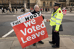 © Licensed to London News Pictures. 11/01/2019. LONDON, UK.   A pro-Brexit demonstrator stands outside the Houses of Parliament talking to a police officer.  MPs are due to vote on Prime Minister Theresa May's Brexit deal on 15 of January.  Photo credit: Stephen Chung/LNP