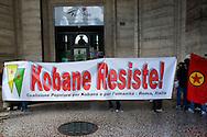 Roma 16 Ottobre 2014<br /> Attivisti della Coalizione Popolare per Kobane  e per l'umanità sanziona  l'ufficio della Cultura e Turismo dell'Ambasciata della Turchia in Piazza della Repubblica con lancio di vernice rossa,frattaglie di animali,scritte sulla vetrine e fumogeni in solidarietà con la resistenza kurda di Kobane, la città a nord della Siria al confine con la Turchia che resiste all'Isis.<br /> Rome October 16, 2014 <br /> Activists of the Popular Coalition to Kobane and humanity sanctions  the Office of Culture and Tourism of the Embassy of Turkey in Piazza della Repubblica with the launch of red paint, animal offal, written on the windows and smoke bombs in solidarity with the Kurdish resistance of Kobane, the city in northern Syria on the border with Turkey that resists the  ISIS.