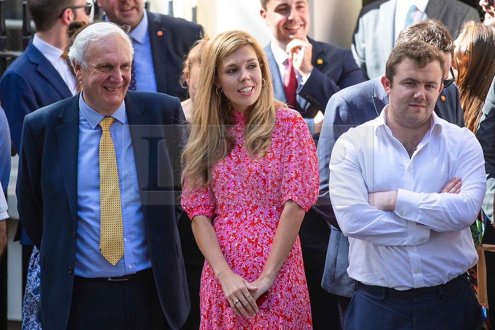 © Licensed to London News Pictures. 24/07/2019. London, UK. Carrie Symonds watches with staff as Boris Johnson enters 10 Downing Street for the first time as Prime Minister. Photo credit: Rob Pinney/LNP
