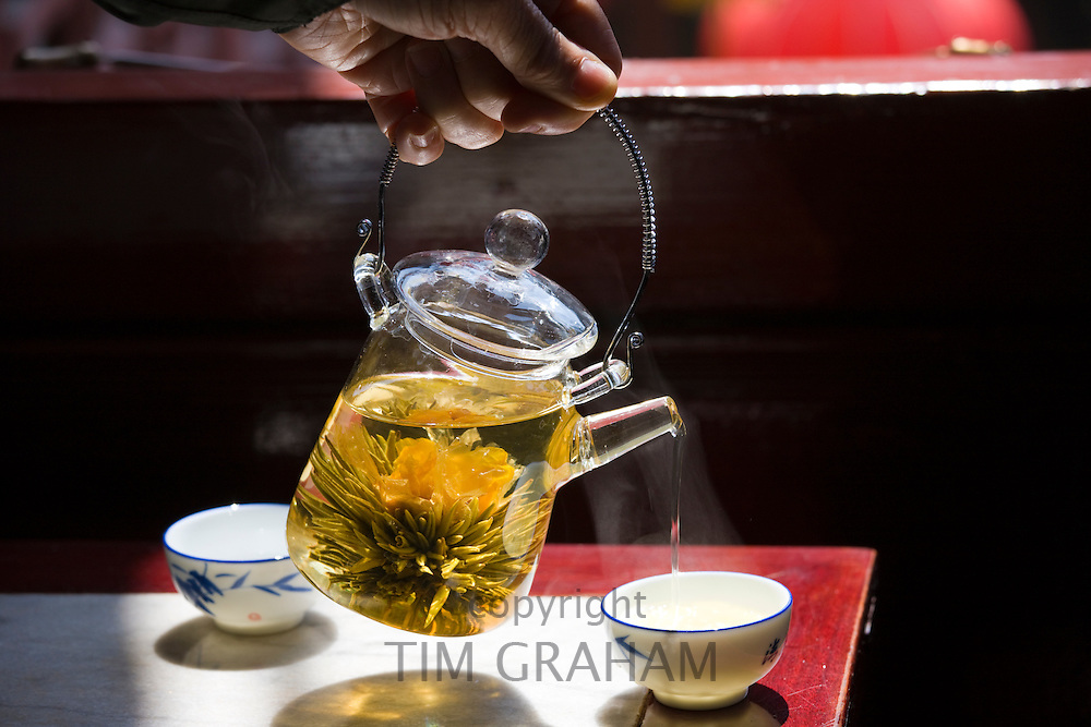 Flower infused tea being poured in the Huxinting Teahouse, Yu Garden Bazaar Market, Shanghai, China