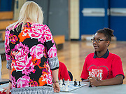 Kailee Bradford waits for chess grandmaster Susan Polgar  to make a move during their game at Ryan Middle School, September 15, 2014.