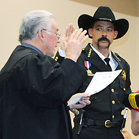 Sheriff Tony Mace takes the oath of office at an official swearing in ceremony Thursday in Grants.