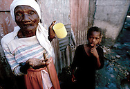 An old woman gestures toward the photographer in the Cite Soliel neighborhood of Port-au-Prince, Haiti in October 1993.
