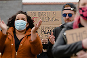 Solidarity NOT silence sign held up as protesters clap the talker addressing the protest during the Black Lives Matter protest in Caerphilly, Wales on 6 June 2020.