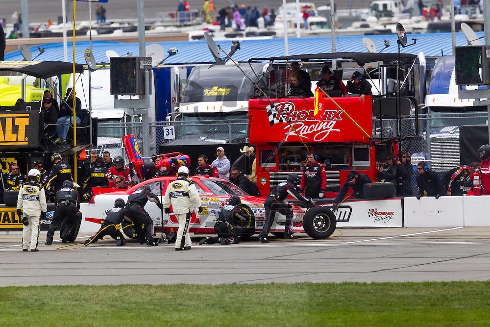 KANSAS CITY, KS - APR 22, 2012:  Kurt Busch (51) races during the STP 400 at the Kansas Speedway in Kansas City, KS.