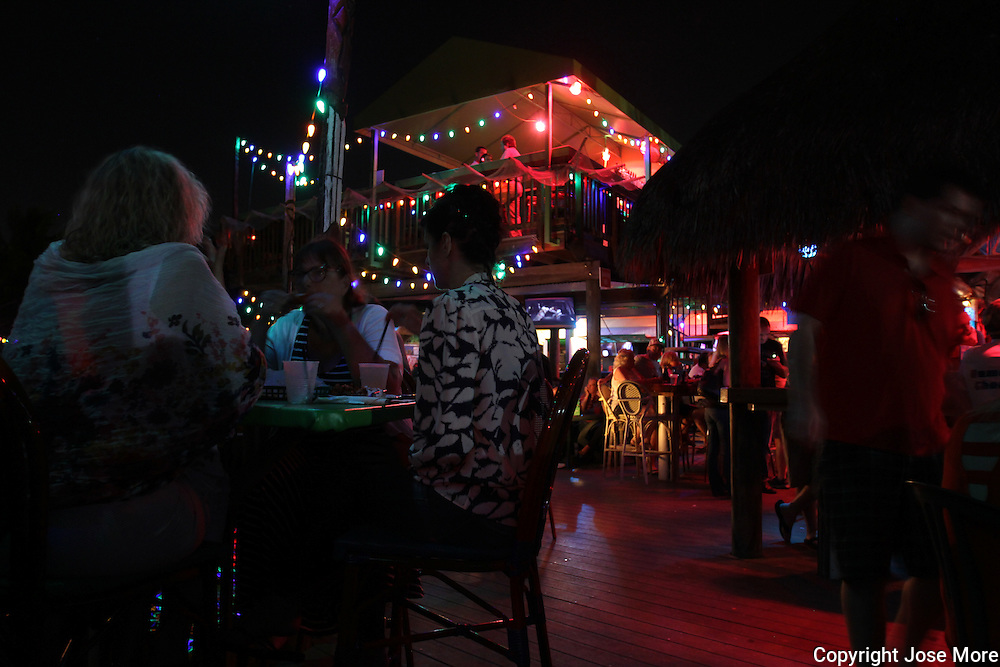 Old Key Lime bar and restaurant accessible either by boat or car offers al fresco dining by the Intracoastal Waterway in South Florida.  Photography by Jose More