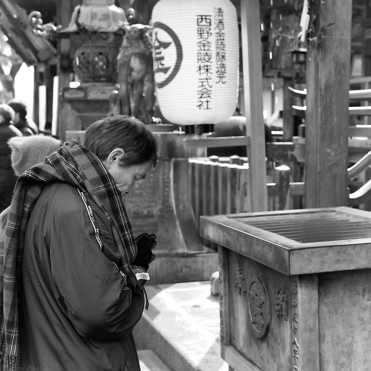 Kompira-san or Kotohira-gu is a large Shinto temple halfway up a mountainside in the Kagawa prefecture on the Japanese Island of Shikoku. What you'll find at the base of the mountain after a leisurely stroll from either of the town's train stations is that stereotypical 70's era martial-arts-movie-forever-ascending staircase, or, to be more accurate, a forever ascending series of staircases. Tourists from all over come throughout the year to climb the steps through a myriad arcade of trinket shops, udon eateries, and vending machines (both literal and metaphorical), and although there are several events during the year that attract more visitors than average, nothing attracts a more curious crowd (local and tourists, young and old, men and women) than Shogatsu, or the first day of the new year (in this case new years 2013).