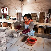 Hunan, Liuyang, Dec. 19..2013 : Zhou Changying, a worker, assembles  fireckrackers for the Western market in a factory .