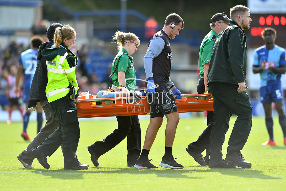 Wycombe Wanderers Matt Bloomfield (10) leaves the pitch injured on a stretcher during the EFL Sky Bet League 1 match between Wycombe Wanderers and Lincoln City at Adams Park, High Wycombe, England on 7 September 2019.