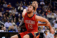 Feb 13, 2017; Phoenix, AZ, USA; New Orleans Pelicans forward Donatas Motiejunas (12) boxes out Phoenix Suns center Alex Len (21) in the first half of the NBA game at Talking Stick Resort Arena. Mandatory Credit: Jennifer Stewart-USA TODAY Sports
