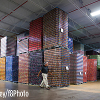 Bob Farley/F8photo.org -- Scott Parks, VP of Manufacturing, Facilities, Fleet and Operations at Buffalo Rock walks pastr thousands of cans wating to be filled.
