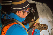 In the pre-dawn glow of a headlamp, Chinese student Li Haoxin (Luke) checks a map prior to a hunt for deer and elk near Alder, Montana,