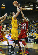 February 11 2013: Iowa Hawkeyes center Morgan Johnson (12) puts up a shot over Nebraska Cornhuskers forward Emily Cady (23) during the first half of the NCAA women's basketball game between the Nebraska Cornhuskers and the Iowa Hawkeyes at Carver-Hawkeye Arena in Iowa City, Iowa on Monday, February 11 2013.