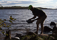 Seven participants and two guides led a Wilderness Inquiry canoe adventure on Brule Lake in the Boundary Waters from Sept. 5 to September 9, 2012...Dillon, a guide, gets water from the Boundary Waters for use in the kitchen.