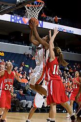 Virginia guard Paulisha Kellum (3) shoots past Davidson guard Alexandra Thompson (10).  The Virginia Cavaliers women's basketball team defeated the Davidson Wildcats 83-68 at the John Paul Jones Arena in Charlottesville, VA on December 20, 2007.