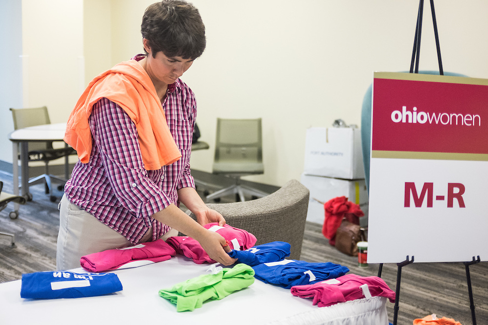 Preparing the checkin table for participants in the first ever OU Women Portrait on Tuesday, June 23, 2015. Over 300 women participated in the photo.  Photo by Ohio University  /  Rob Hardin