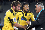 Hurricanes' Andrew Hore is presented for his 100th cap for Hurricanes. Super 15 rugby union match, Blues v Hurricanes at Eden Park, Auckland, New Zealand. Saturday 19th March 2011. Photo: Anthony Au-Yeung / photosport.co.nz