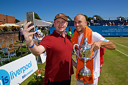 LIVERPOOL, ENGLAND - Sunday, June 18, 2017: Men's Champion Steve Darcis (BEL) with the trophy stops for a selfie with a supporter during Day Four of the Liverpool Hope University International Tennis Tournament 2017 at the Liverpool Cricket Club. (Pic by David Rawcliffe/Propaganda)