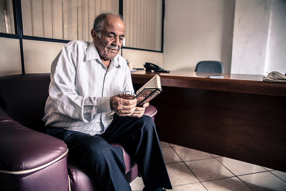 Mr. Mohamed, one of the founder of the Islamic center in Foz do Iguacu and one of the first member of the community to start the building of the mosque. He came to Brazil from Lebanon during the 70s. Photographed here while reading the Quran