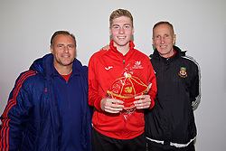 NEWPORT, WALES - Sunday, May 22, 2016: Chris Boyes is presented with his cap by former Wales players Clayton Blackmore [L] and Joey Jones [R] during the Football Association of Wales' National Coaches Conference 2016 at Dragon Park FAW National Development Centre. (Pic by David Rawcliffe/Propaganda)